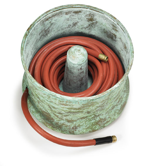 the garden hose pot sits on the ground so you can easily place it near a bush that can partially hide it if you prefer however if you choose one that